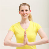 Woman with her hands together in a yoga pose Royalty Free Stock Photography