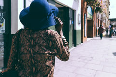 A Woman and her Hat. Color street picture from Hackney Overground Station. London Royalty Free Stock Images
