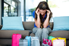 Woman with her head in her hands surrounded by gifts Stock Photography