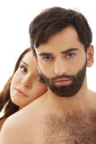 Woman with her head on man's back. Stock Images