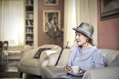 Woman in her home. Woman in her beautiful old fashioned home Royalty Free Stock Photo