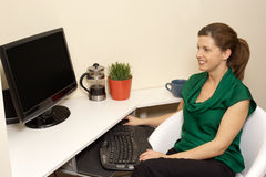 Woman in her home office Royalty Free Stock Image