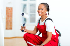 Woman in her home renovating diy Stock Photos