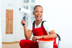 Woman in her home renovating diy royalty free stock image