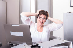 Woman in her homeoffice has stressy moment Royalty Free Stock Images
