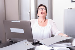 Woman in her homeoffice has stressy moment.  Stock Photography
