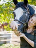 Woman With Her Horse Stock Image