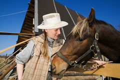 Woman and her horse at farm Royalty Free Stock Photos