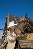 Woman and her horse at farm Stock Photo