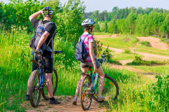 Woman and her husband were on bikes. On the mountain stock photo