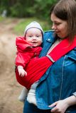 Woman and her infant baby outdoors Royalty Free Stock Photography