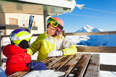 Woman and her kid having rest in cafe after skiing Royalty Free Stock Photography