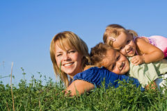 Woman and her kids playing outdoors Royalty Free Stock Images
