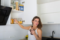 Woman at her kitchen in the morning Stock Image