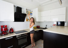 Woman at her kitchen in the morning Royalty Free Stock Image