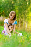 Woman and her little daughter Royalty Free Stock Photos