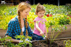 Woman with her little daughter in garden Royalty Free Stock Photo