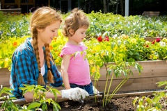 Woman with her little daughter in garden Royalty Free Stock Photography