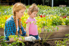 Woman with her little daughter in garden Stock Photo
