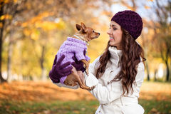 Woman with her little dog in autumn Stock Photo