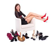Woman with her many shoes Stock Photos
