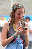 A woman with her mobile phone at FIB Festival Stock Image