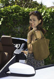 Woman with her new convertible Stock Image