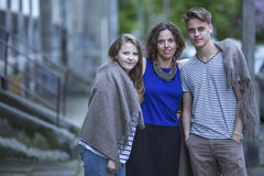 Woman with her older children outdoors. Family. Royalty Free Stock Image