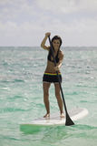 Woman with her paddle board Stock Photography