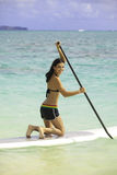 Woman with her paddle board Royalty Free Stock Images