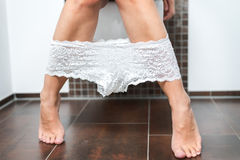 Woman with her panties around her ankles Royalty Free Stock Images