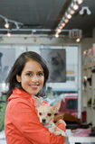 Woman with her pet chihuahua Royalty Free Stock Image