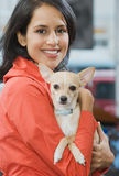 Woman with her pet chihuahua Royalty Free Stock Images