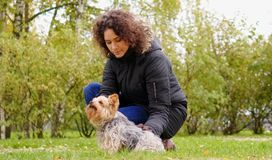 Woman with her pet dog.  Royalty Free Stock Photography