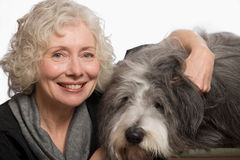 Woman with her pet dog Stock Images