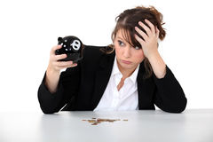 Woman with her piggy bank Royalty Free Stock Image