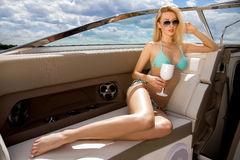 Woman on her private yacht. Young adult attractive sensuality and sexy blonde woman on her private yacht Stock Photos