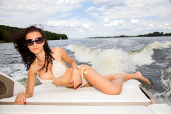 Woman on her private yacht. Young adutl attractive sensuality and sexy brunette woman on her private yacht Stock Photo