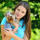 Woman with her puppy in a park Stock Images