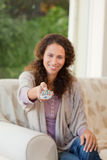 Woman with her remote Royalty Free Stock Photos