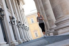 Mature Woman Jogging In The City Stock Image
