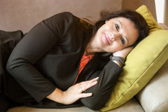 Woman in her 40s lying on couch and resting Stock Photo