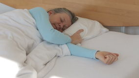 Woman in her 50s sleeping in bed restless stock footage