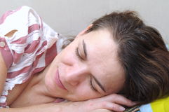 Woman in her 40 s sleeping and smiling Royalty Free Stock Photos