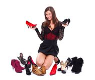 Woman among her shoes Stock Photos