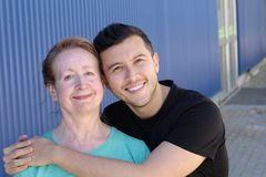 Woman in her sixties with man in his twenties stock images
