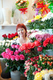 Woman in her small  flower shop Royalty Free Stock Image