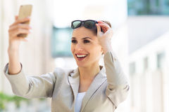 Woman with her smartphone Royalty Free Stock Photo