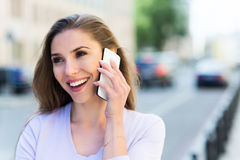 Woman with her smartphone Stock Photography