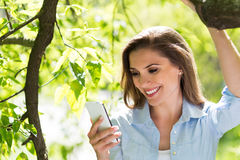 Woman with her smartphone Royalty Free Stock Images